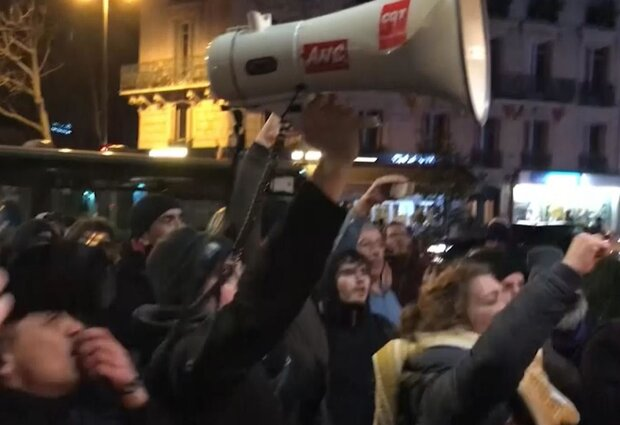 Macron rushed out of Paris theater after protesters try to confront him