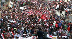 Iraqi people hold massive anti-US rally in Baghdad