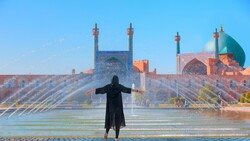 A sightseer revels in the picturesque atmosphere of the UNESCO-registered Imam Square in Isfahan, central Iran. (Shutterstock)
