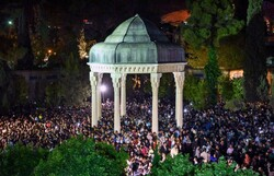 People celebrate Iranian New Year's Eve at the mausoleum of Hafez in Shiraz on March 20, 2018. (Mehr/Amin Berenjkar)
