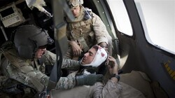 File photo shows a US soldier being evacuated from Afghanistan's Helmand province in 2011 after receiving a head injury. (Photo by AFP)