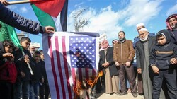 Palestinian demonstrators burn a US flag during a protest against the so-called deal of the century in Khan Yunis in the southern Gaza Strip on January 31, 2020. (Photo by AFP)