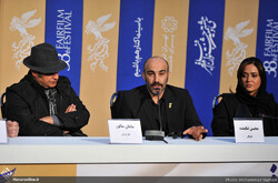 """Director Saman Salur and """"Puff, Puff, Pass"""" cast members Mohsen Tanabandeh and Parinaz Izadyar attend a press conference during the 38th Fajr Film Festival at Mellat Cineplex in Tehran on February 1,"""