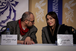 "Director Behrang Dezfulizadeh and ""Silence, the Cochlea"" cast member Hanieh Tavassoli attend a press conference during the 38th Fajr Film Festival at Tehran's Mellat Cineplex on February 2, 2020. (Meh"