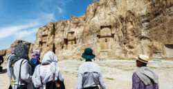 Foreign travelers look at ancient rock–hewn tombs and bas-relief carvings at Naqsh-e Rostam, which is situated near the UNESCO-registered Persepolis southern Iran. (Photo: Richard I'Anson)