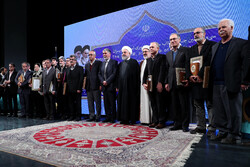 President Hassan Rouhani and scholars pose during the 37th Iran's Book of the Year Awards at Tehran's Vahdat Hall on February 5, 2020. (President.ir)