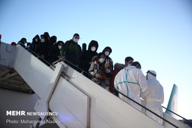Iranian students confined in Wuhan return home