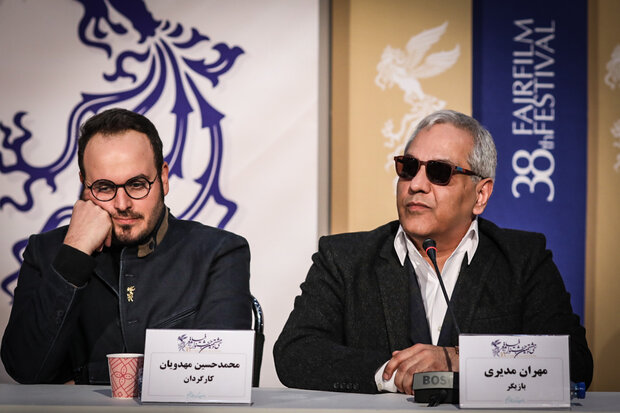 "Director Mohammad-Hossein Mahdavian and cast member Mehran Modiri attend a press conference for ""Walnut Tree"" during the 38th Fajr Film Festival at Mellat Cineplex in Tehran on February 4, 2020. (Mehr"
