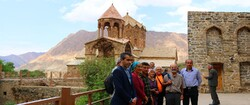 Travelers pose for a photo during their visits to the UNESCO-tagged Saint Stepanos Monastery in northwest Iran.