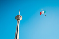 Parachutists jump from Milad Tower