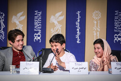 "Cast members Ruhollah Zamani, Abolfazl Shirzad and Shamila Shirzad, who are the students in a special school for child workers in Tehran, attend a press conference for ""The Sun"""