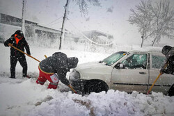 Rescue operation to help people stranded in vehicles stuck in snow in Gilan