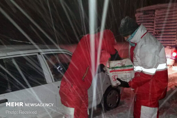 Rescue operation to help people stranded in vehicles stuck in snow