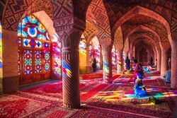 Travelers visit the picturesque interior hall of the 19th-century Nasir al-Molk Mosque in Shiraz, southern Iran.