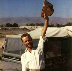 "Robert H. Dyson, Jr. with the famous ""Gold Bowl"" of Hasanlu at the time of its discovery in 1958."