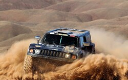 File photo depicts a huge 4WD competing in an off-road desert route