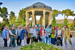 Foreign travelers pose for a photograph during their visits to Hafezieh, a major cultural tourist spot where Hafez, the illustrious Persian poet of the 14th century, is laid to rest in Shiraz, Southern Iran.     ******    (PHOTO CREDIT: letsvisitpersia.com)