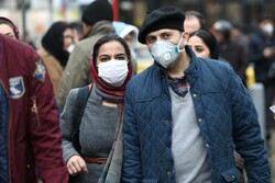 Iranian couple wearing protective masks to prevent contracting a coronavirus walk at Grand Bazaar in Tehran, Iran February 20, 2020. Photo credit: WANA (West Asia News Agency)