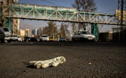 Single discarded latex glove on the street, used by people preventing coronavirus infection