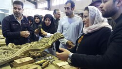 World Crafts Council-Asia Pacific Region Director Ghada Hijavi (2nd R) visits a woodcarving workshop in Iran's Malayer in December 2019.
