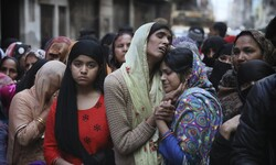 Relatives mourn Mohammad Mudasir, 31, who was killed in rioting in Delhi. (Photo: Manish Swarup/AP)
