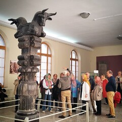 People visit a majestic capital of a column from Persepolis, the ceremonial capital city of the Persian Achaemenid Empire (ca. 550-330 BC), at the National Museum of Iran.