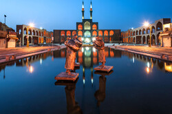A view of three-story Amir Chakhmaq Complex with a scenic pool in the front, Yazd, central Iran.