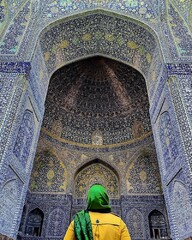A traveler looks at the main portal of Imam Mosque in Isfahan, central Iran.