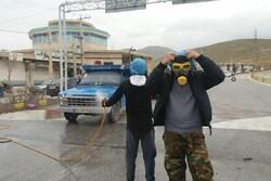 ضدعفونی خودروهای عبوری از مبادی ورودی شهرستان نهاوند