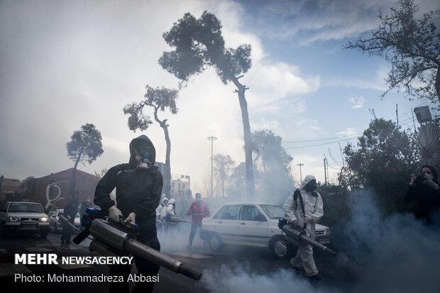 Firefighters disinfecting a neighborhood in S Tehran