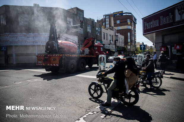 Firefighters disinfecting a neighborhood in E Tehran