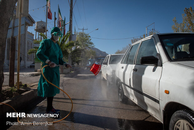 Students disinfect passing cars against COVID-19 in Shiraz