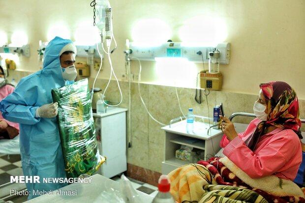 توزیع غذای متبرک آستان قدس رضوی در بیمارستان ولیعصر (عج) زنجان