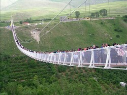 Sightseers cross a gigantic suspension bridge linking two hills in Meshkinshahr, Iran's Ardabil province.