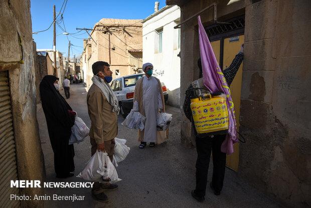 توزیع اقلام بین مجاورین حرم حضرت سید علاالدین حسین(ع) شیراز