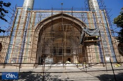 A portico of the Jameh Mosque of Qazvin is seen behind scaffolding in an undated photo.