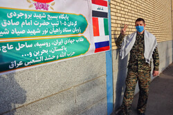 Seminary student from Russia disinfecting thoroughfares in Qom