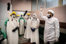 تہران میں طلاب کورونا وائرس سے جاں بحق افراد کو غسل و کفن دیتے ہیں