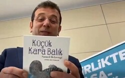 """Istanbul Mayor Ekrem Imamoglu holds a copy of the Turkish version of """"Little Black Fish"""" in an undated photo."""
