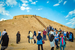 An undated photo depict holidaymakers visiting the prehistorical Ozbaki hill situated near Nazarabad, some 80 km west of Tehran.