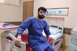 Wrestler Alireza Karimi undergoes successful knee surgery