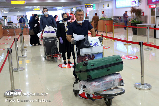 Disinfecting, monitoring health of passengers in Kish