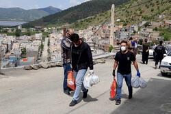 دیدار پرویز پرستوئی و قهرمانان کشتی با کولبران شهرستان مریوان