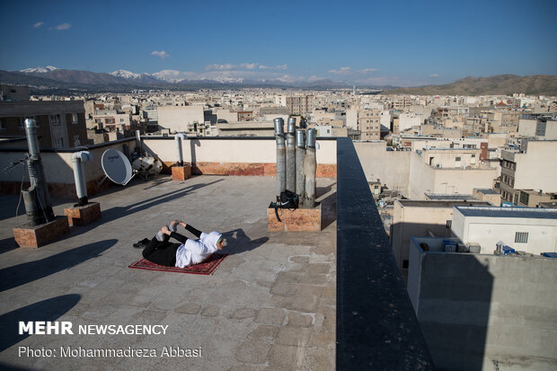 Iranians working out on rooftops amid the pandemic