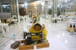 """ليلة القدر في ورشة خياطة الملابس الواقية بمرقد السيد """"علي بن مهزيار"""" بأهواز / صور"""