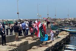 الغزاويون يتظاهرون تضامناً مع العالم في الحرب ضد كورونا