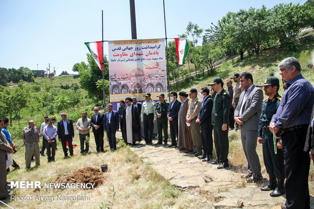 Planting olive sapling to mark Intl. Quds Day