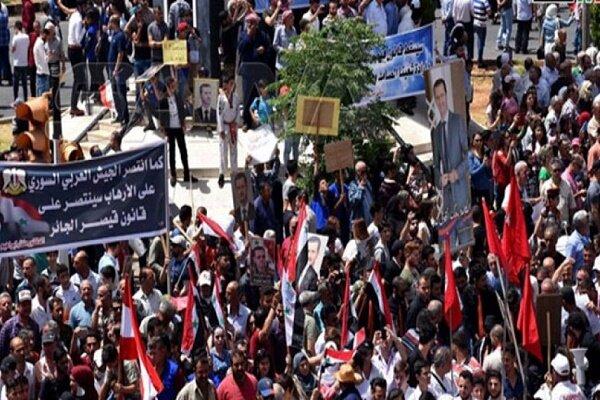 Suriye'de 'Esad'a destek, yaptırımlara hayır' gösterisi