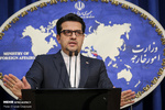 Iran rejects reports on partial sanctions removal