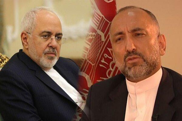 Zarif, Atmar discuss Afghan peace talks on phone